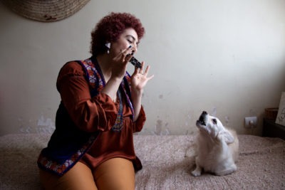 Saghar plays the harmonica, and her dog Happy accompanies her. She currently works as a freelance textile designer at a film production agency in Tehran.