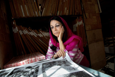 """I struggled to be noticed in society and held my own in a male-dominated field,"" says Maryam, a veteran Iranian photographer. She looks at the test print of her book The Government of 80, printed by Nazar Publishing House in Tehran. Forty years after the Islamic Revolution in 1979, she shows the second part of her pictures in the book The Government of 80, which shows the events after the revolution."